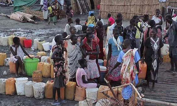"""A grab made from a video released by the United Nations Mission in South Sudan (UNMISS) on April 23, 2014 shows displaced people gathering water at a camp in Bentiu, on April 22, 2014. Rebel gunmen in South Sudan massacred """"hundreds"""" of civilians in ethnic killings when they captured the oil town of Bentiu last week, the UN said on April 21, one of the worst reported atrocities in the war-torn nation. In the main mosque alone, """"more than 200 civilians were reportedly killed and over 400 wounded,"""" the UN mission in the country said, adding there were also massacres at a church, hospital and an abandoned UN World Food Programme (WFP) compound.  AFP PHOTO / HO / UNMISS  RESTRICTED TO EDITORIAL USE - MANDATORY CREDIT """"AFP PHOTO / HO / UNMISS """" - NO MARKETING NO ADVERTISING CAMPAIGNS - DISTRIBUTED AS A SERVICE TO CLIENTS"""